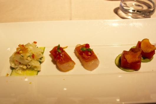 From left to right: seppia (cuttlefish tagliatelle, soffrito crudo, bottarga di muggine, lemon), dentice (pacific snapper, prosciutto, celery, tomato), and tonno (bigeye tuna, oyster crema, crispy sunchoke).